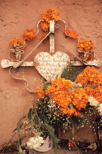 Cross with flowers on the streets of Puebla